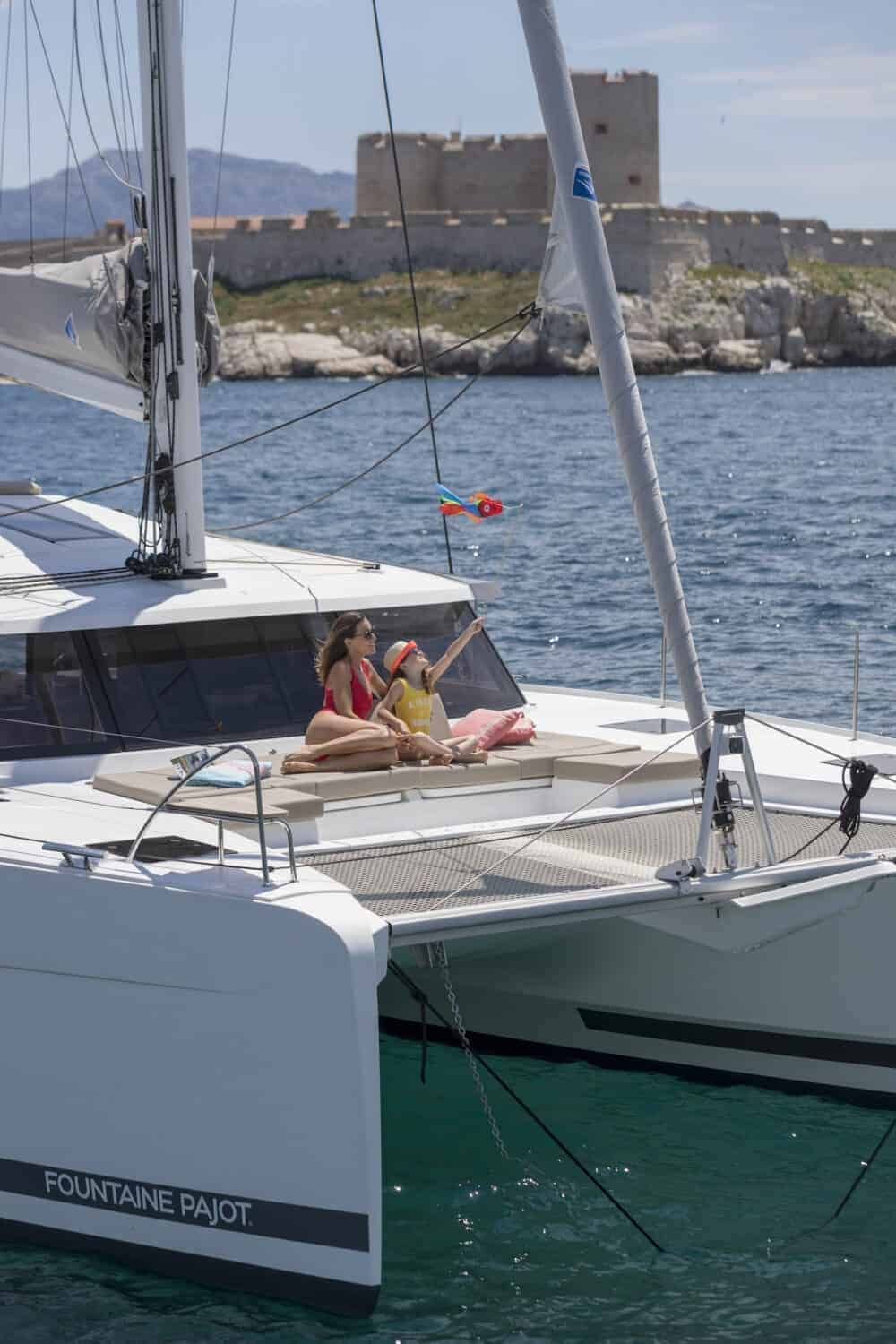 Mother and daughter relaxing on the front deck of the Beautiful and luxurious design of the spacious head of the Fountaine Pajot Astrea 42