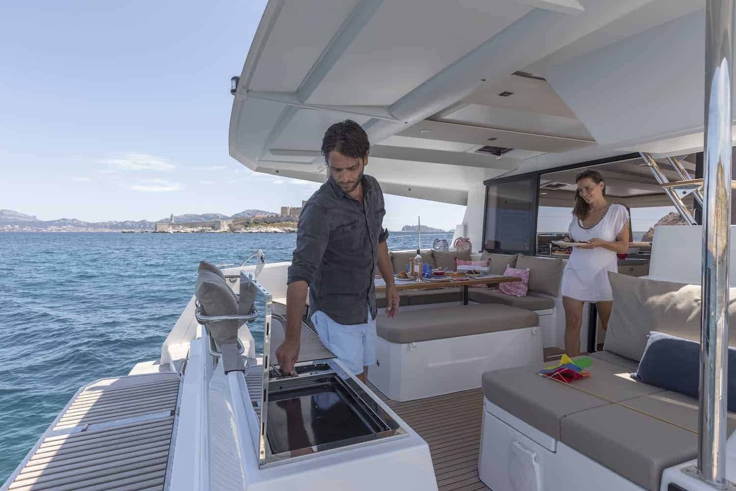 Coupe preparing dinner on the massive and spacious cockpit area of the Beautiful and luxurious design of the spacious head of the Fountaine Pajot Astrea 42