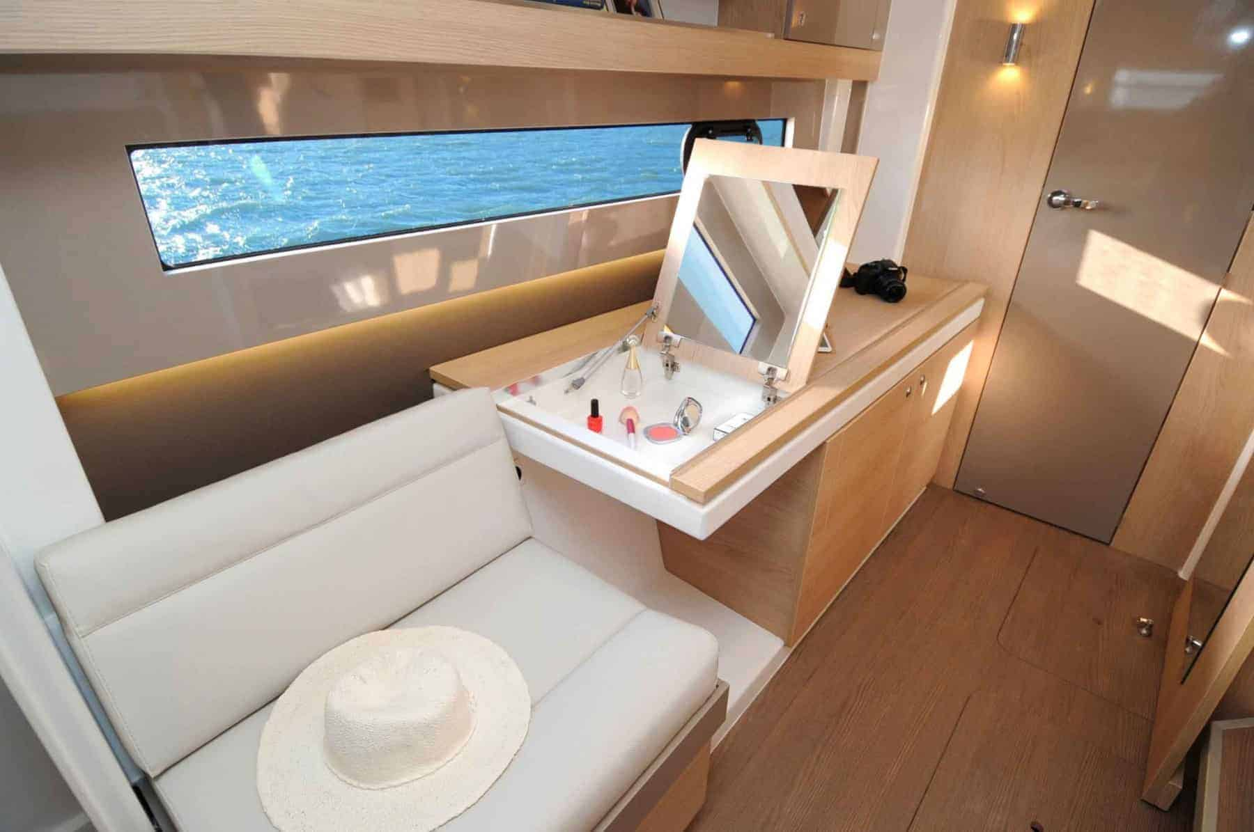 An open makeup cabinet and a hat on the sofa next to it in the beautiful cabin of the Bali 4.1