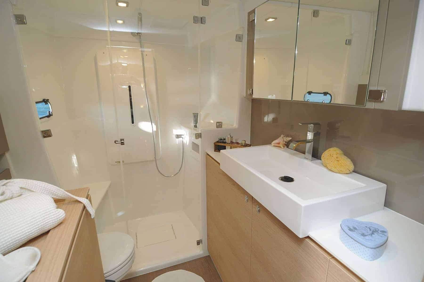 The beautiful shower and sink in the head of the Bali 4.1 catamaran