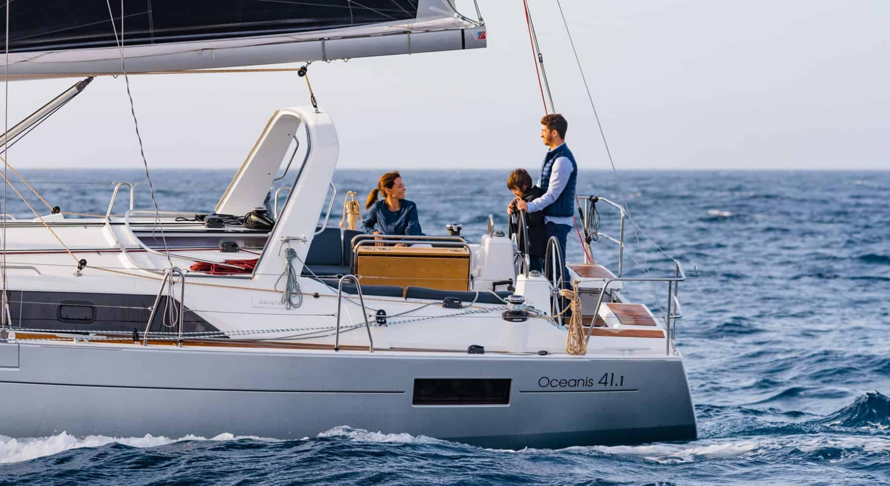 Family enjoying the Benteteau Oceanis 44.1 while sailing through the crashin waves