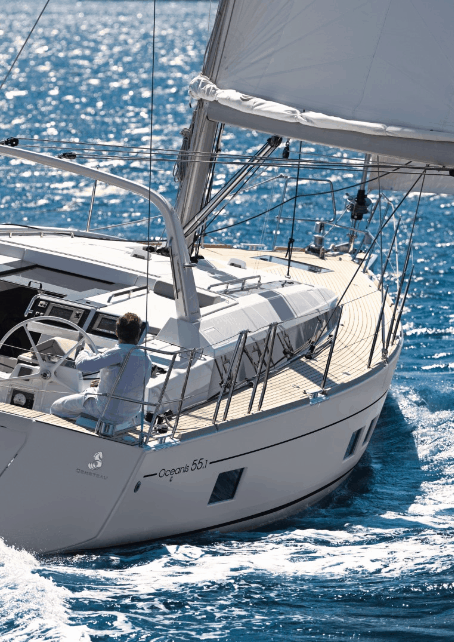 Man sailing the Beneteau Oceanis 55.1 through the waves