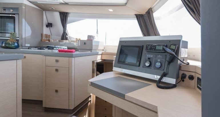 The smartly designed navigation area close to the galley of Fountaine Pajot Saona 47