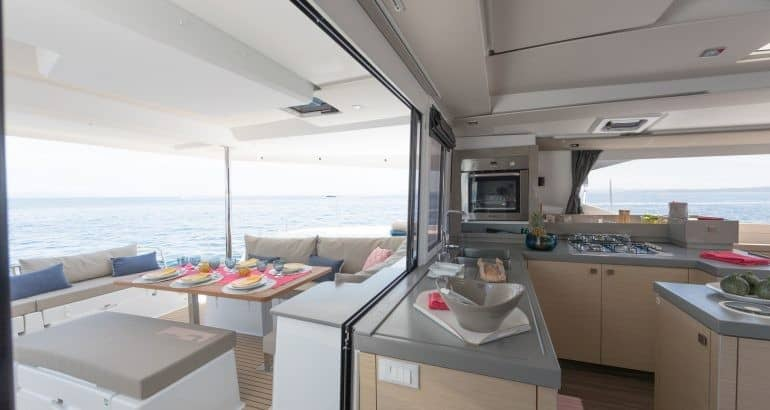 Galley and deck of the Fountaine Pajot Saona 47 with a slidable window that opens up the space between galley and deck
