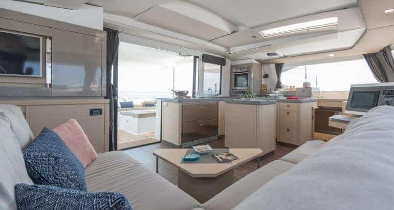 Galley and saloon of the Fountaine Pajot Saona 47 with a slidable window that opens up the gap between galley and deck
