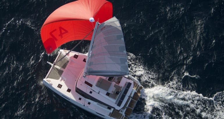 Aerial view of the Fountaine Pajot Saona 47 with wind in its sail a sunny, beautiful day