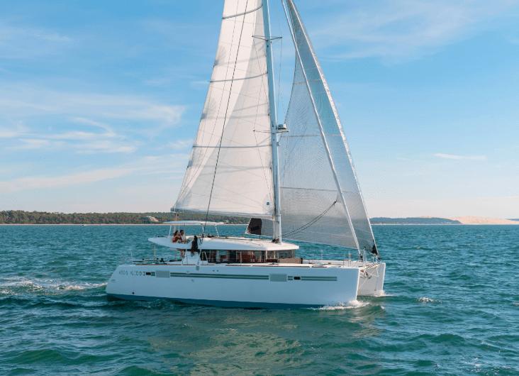 The lagoon 450 S sailing through the calm water