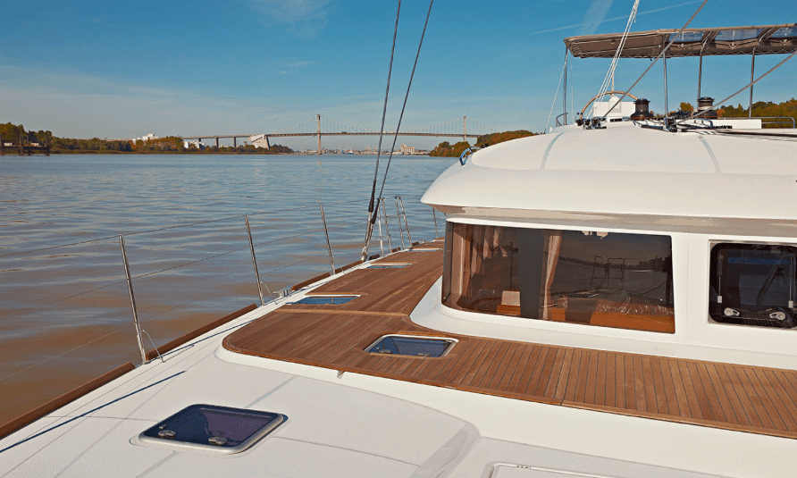 Beautiful view of the deck on the Lagoon 620 with a bridge in the background