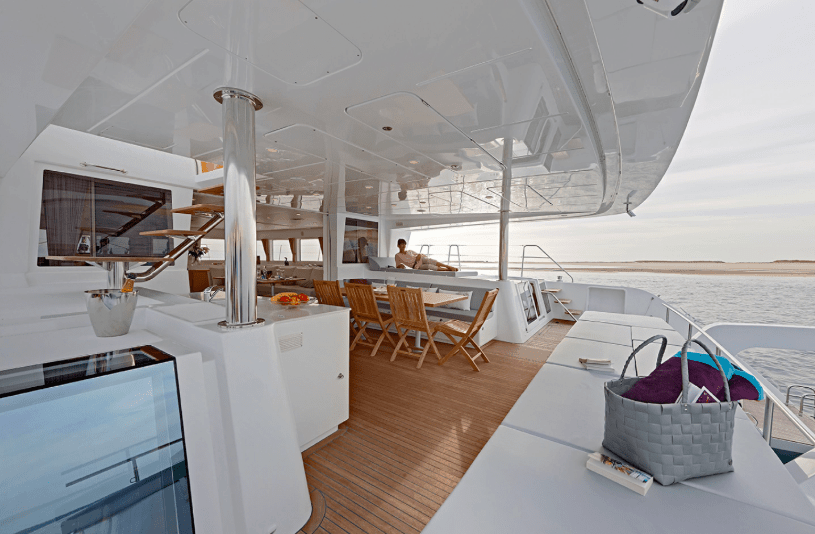 Beautiful view of the deck with kitchen table on the Lagoon 620