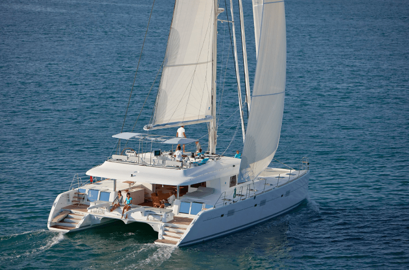 Yacht Lagoon 620 sailing on the ocean, picture from behind