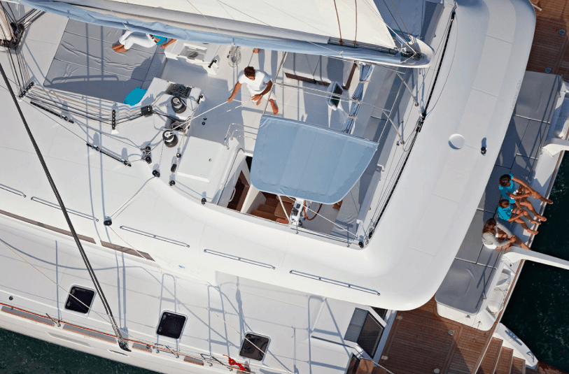 People enjoying the flybridge and rear of a yacht