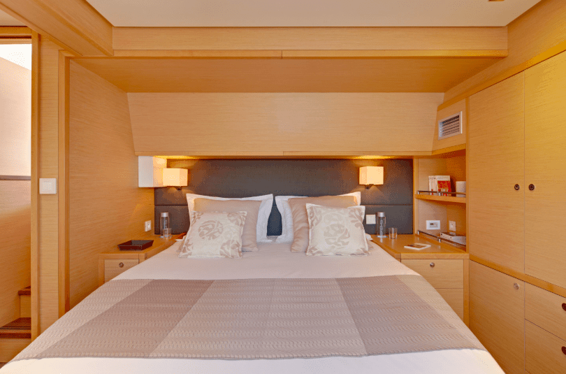 Queen size bed in one of the cabins of the Lagoon 620