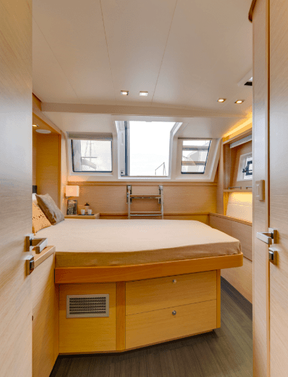 Cabin in the Lagoon 620 with stairs heading out to deck