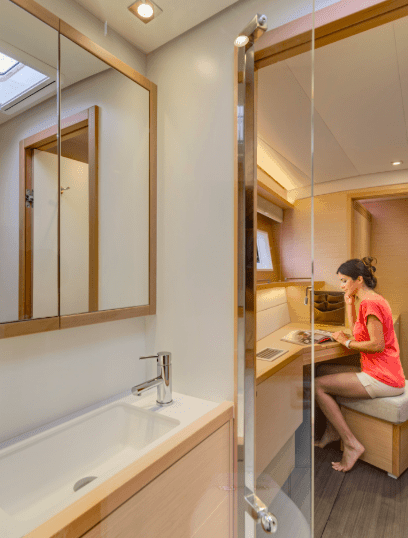 Woman sitting in a cabin next to the head of the yacht 620