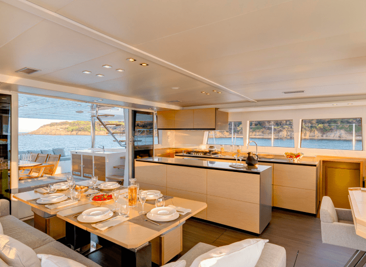 Interior design of the saloon and galley in Lagoon 620 yacht