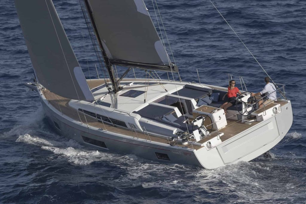 Couple enojying the Beneteau Oceanis 51.1 while crusing through the waves