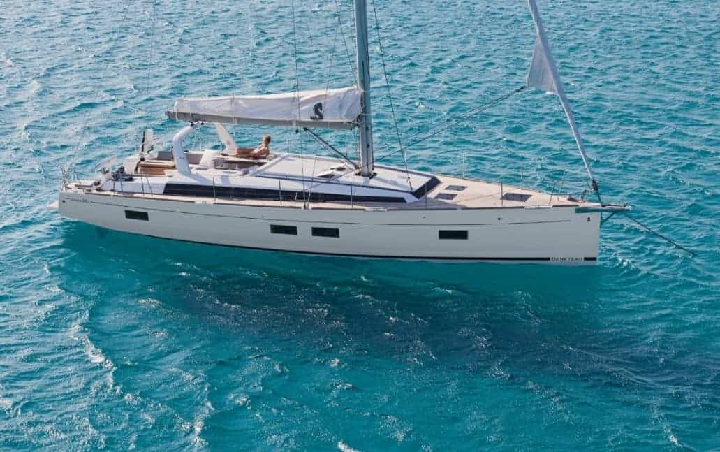 Woman sun bathing on the spacious front deck of the Beneteau Oceanis 55.1