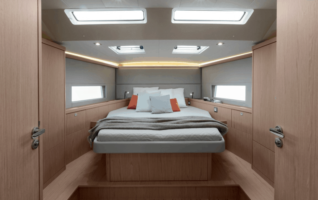Sleep comfortable on the queen size bed in one of the Beneteau Oceanis 55.1 cabins