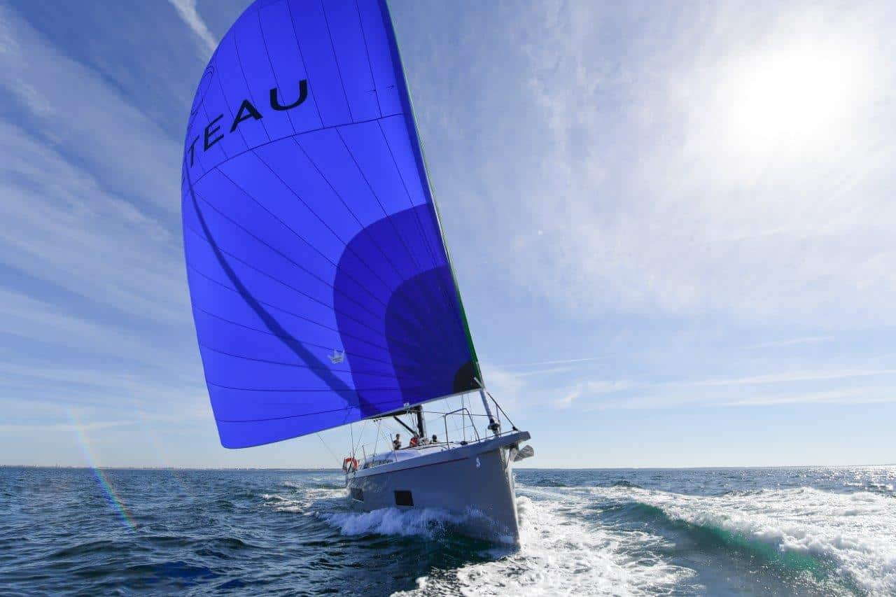 the elegant Beneteau Oceanis 46.1 sailing with wind in its sail towards the camera a sunny day