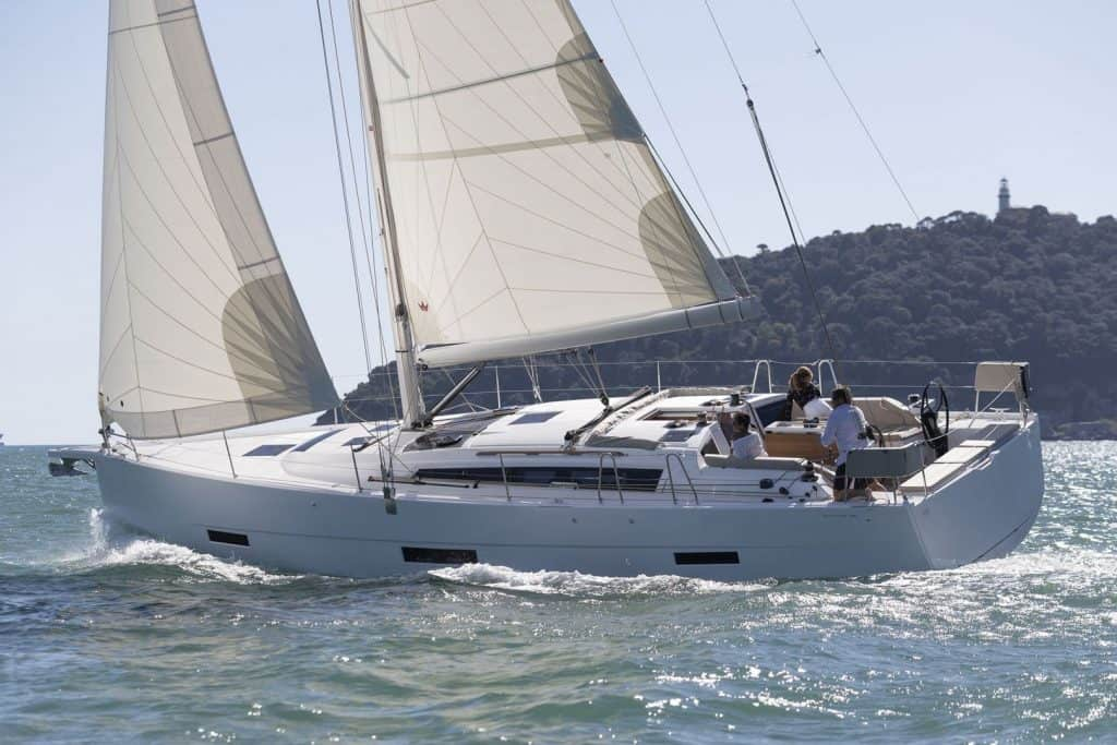 Dufour 430 Grand Large in action with wind in its sail, going fast ahead on a sunny day