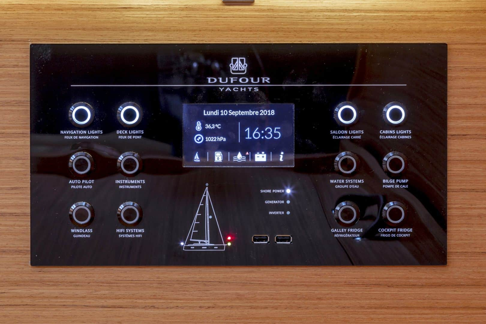 Slick looking control panel with display and buttons to control difference things on the boat