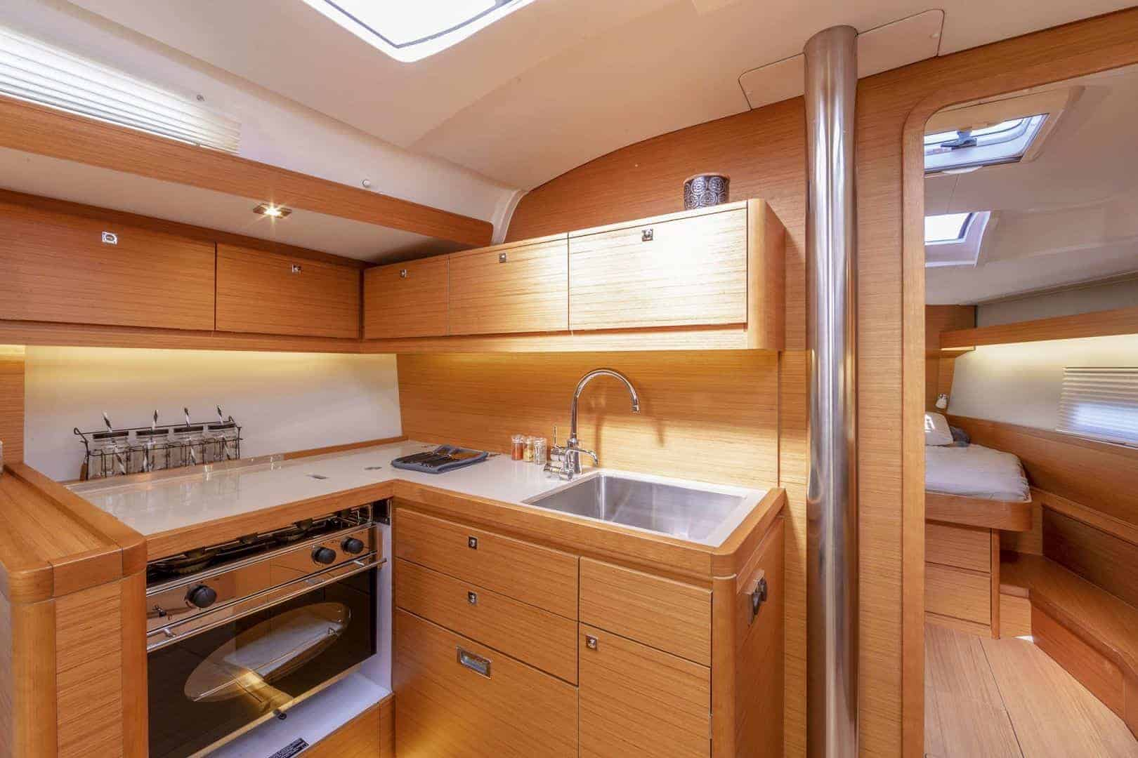 Dufour Grand Large 430's galley with beautifully designed sink, stove and countertop
