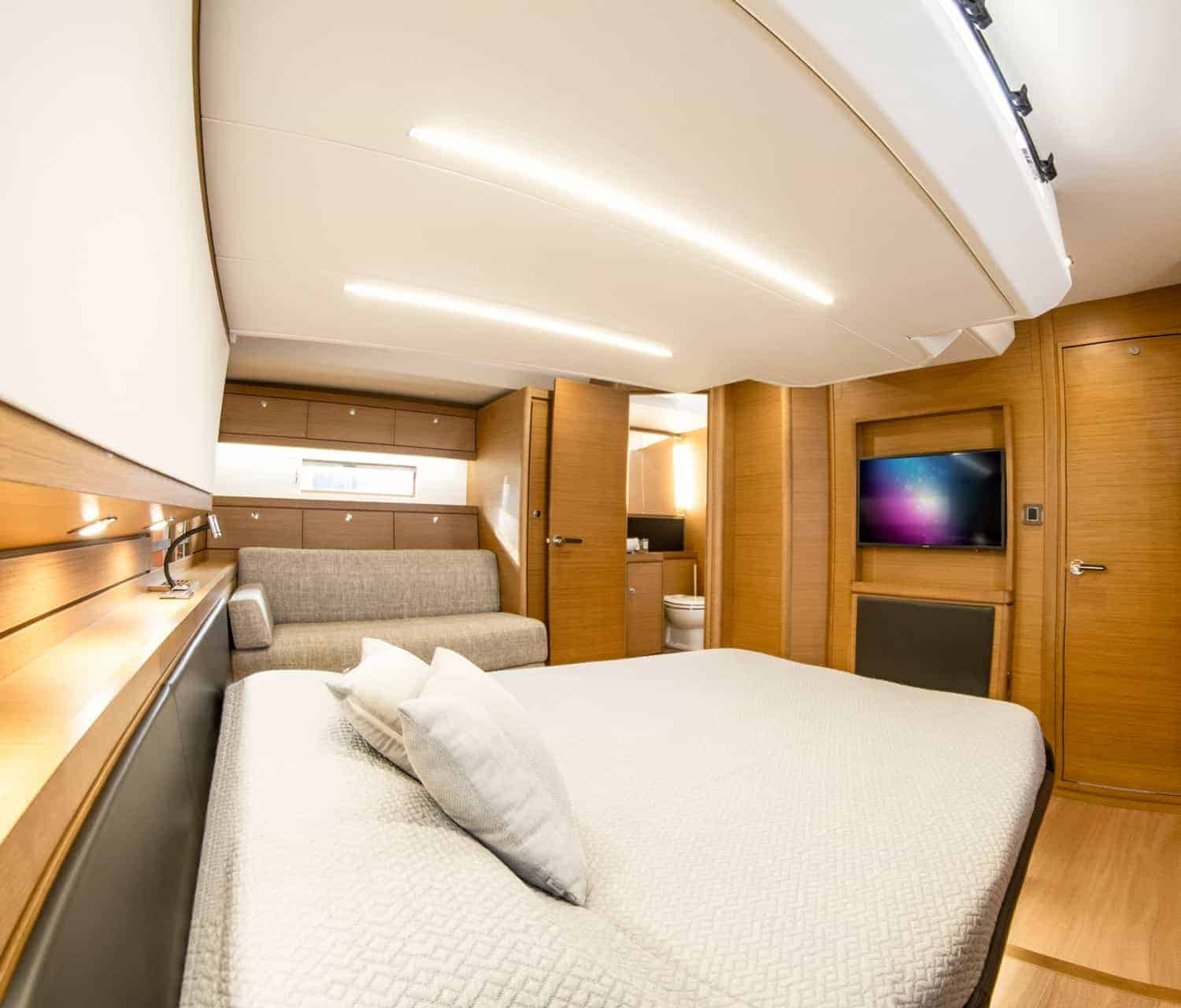 Enjoy a movie while relaxing in the luxurious owners cabin in the Dufour Exclusive 63