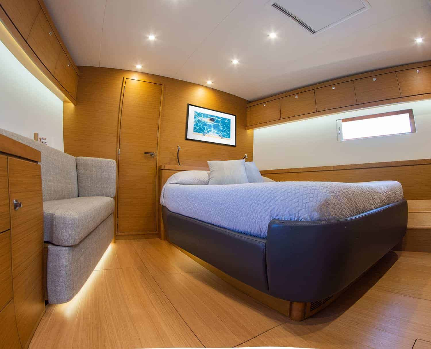 Luxurious and spacious owners cabin with a beautiful double bed