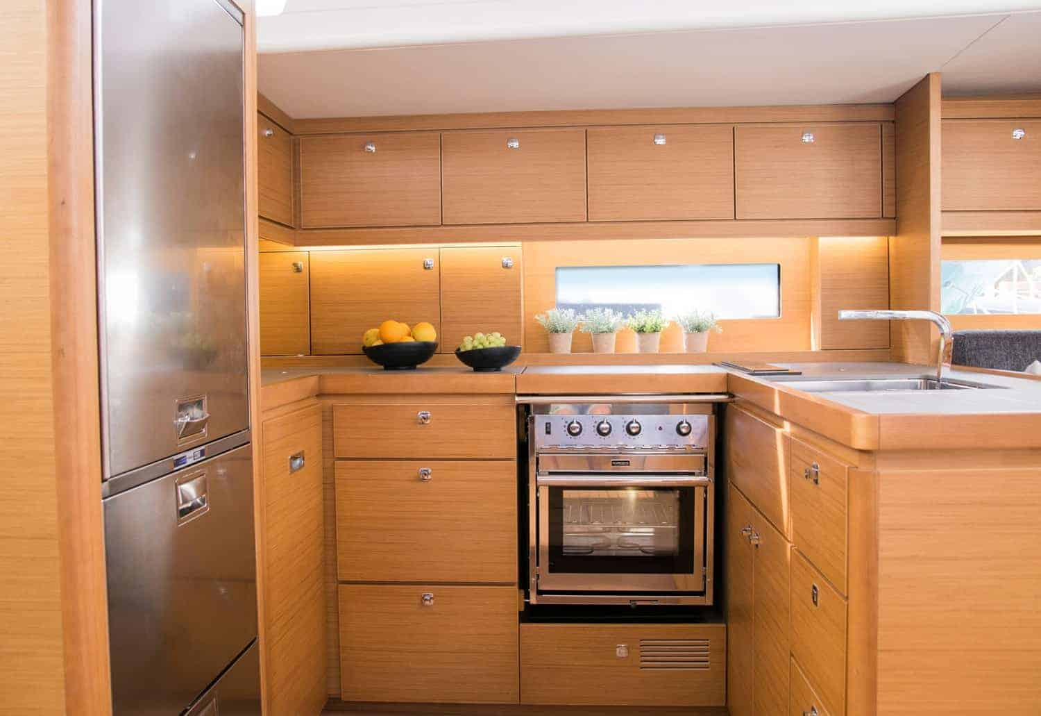 Luxurious and minimalistic, fully equipped kitchen area of the Dufour Exclusive 63
