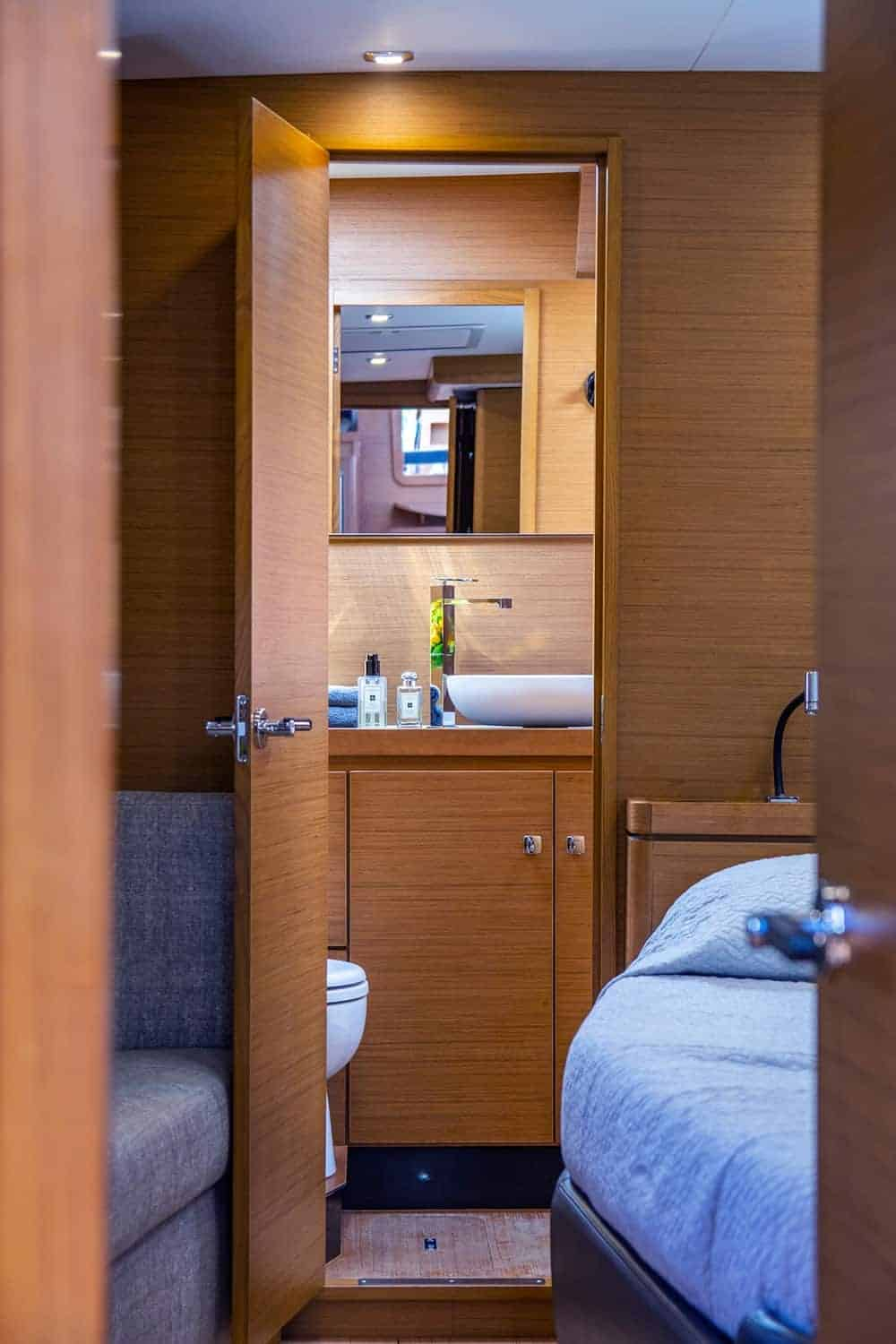 Peak into the beautiful owners cabin private head of the Dufour Exclusive 63