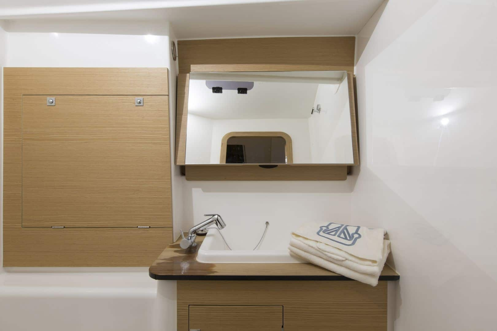 Head of the Dufour GL 460 with slik looking sink and wooden interior
