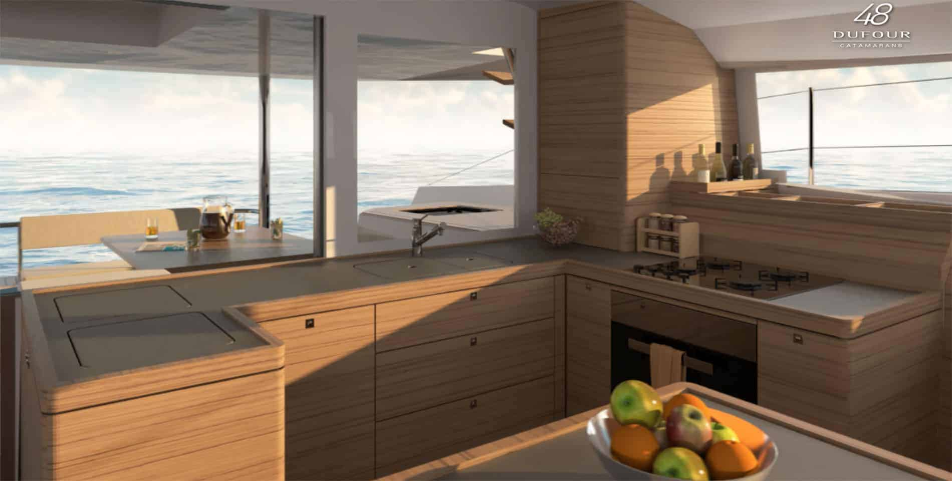 3D animated galley of the Dufour Catamaran 48 with nice view of the water outside and a bowl of fruit in the foreground