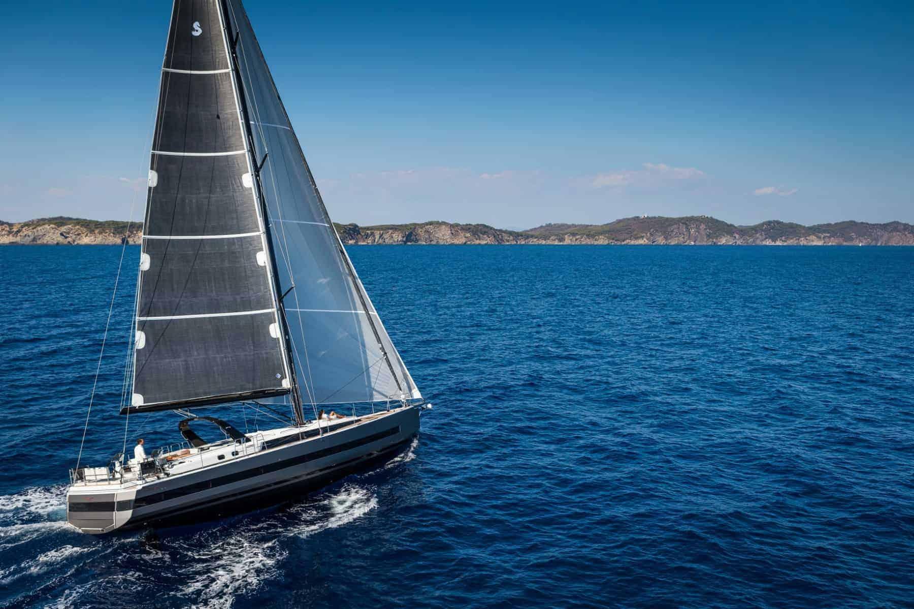The Beneteau Oceanis Yacht 62 speeding through the calm waves towards the horizon