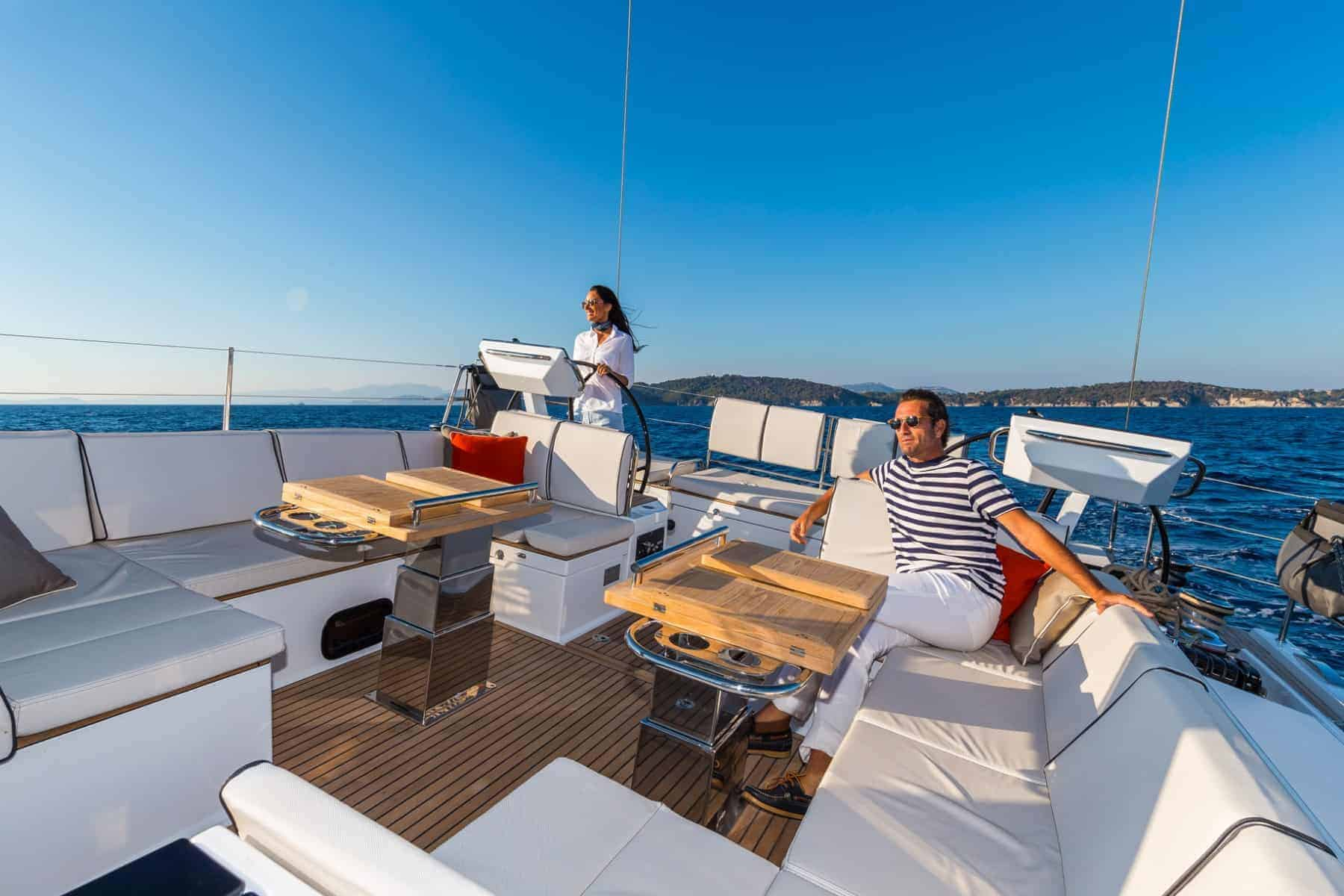 Couple relaxing at the spacious cockpit area of the Beneteau Oceanis Yacht 62