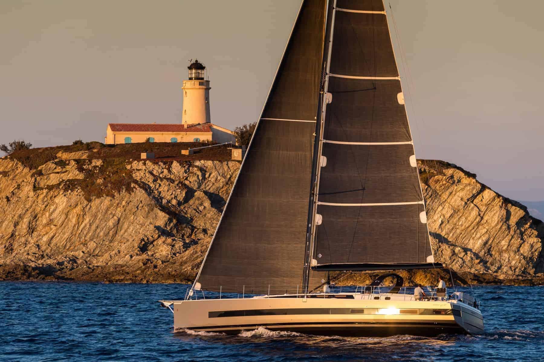 The Beneteau Oceanis Yacht 62 crusing along side beautiful coastline