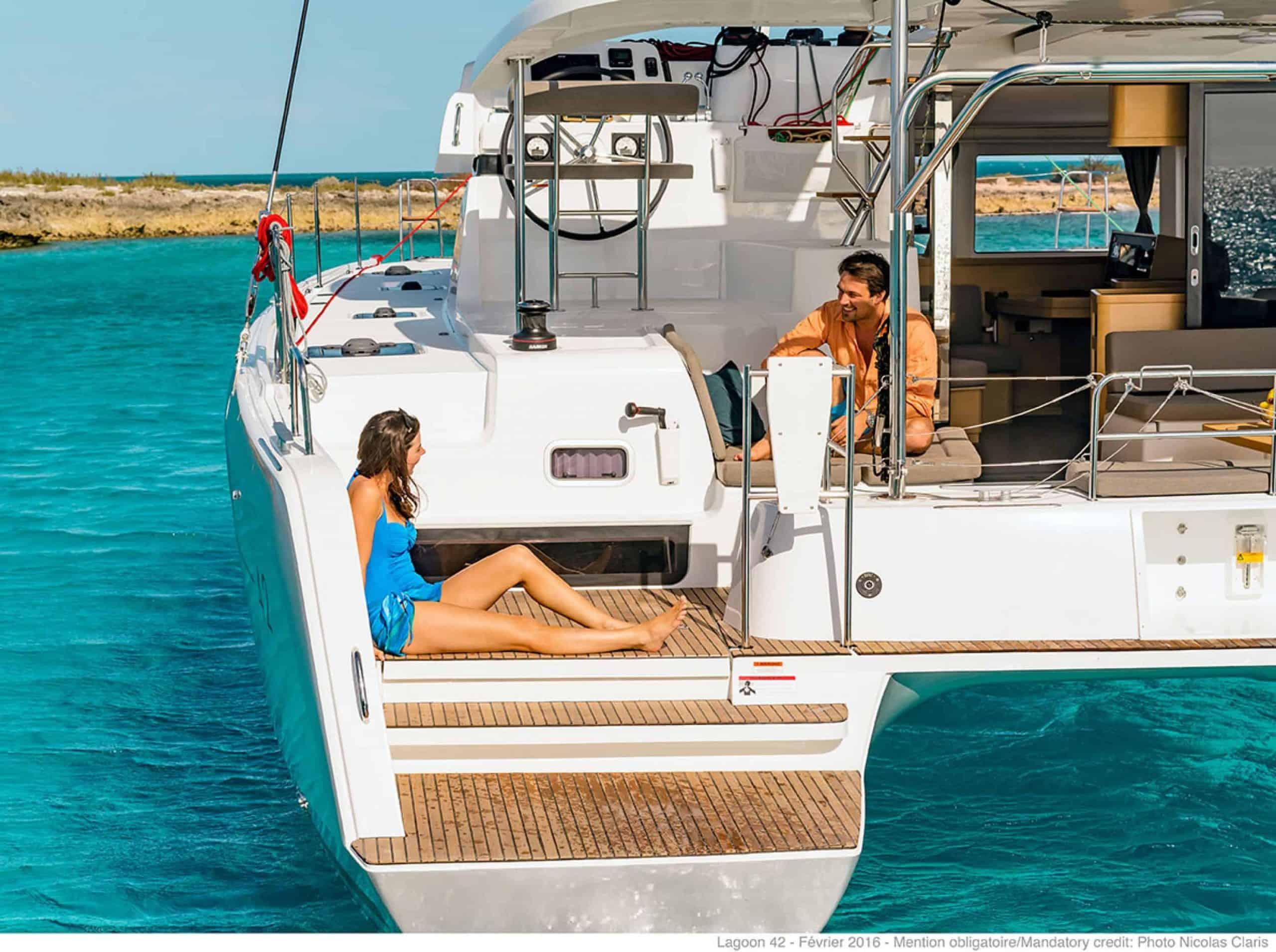 Couple having a chat on the rear of the lagoon 42