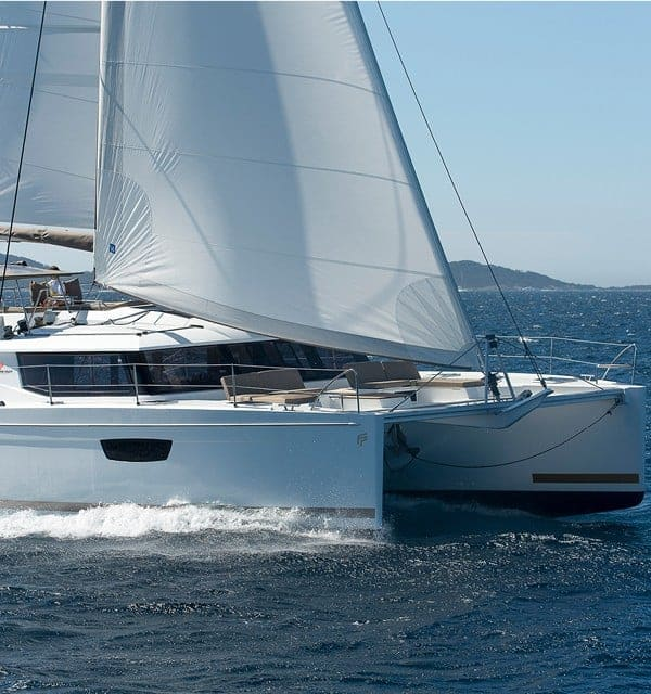 Fountaine Pajot SABA 50 in action with wind in its sail during a sunny day