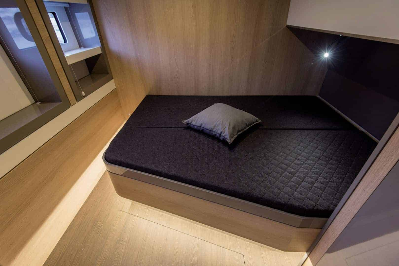 Luxurious bed in one of the cabins of the Bali 5.4