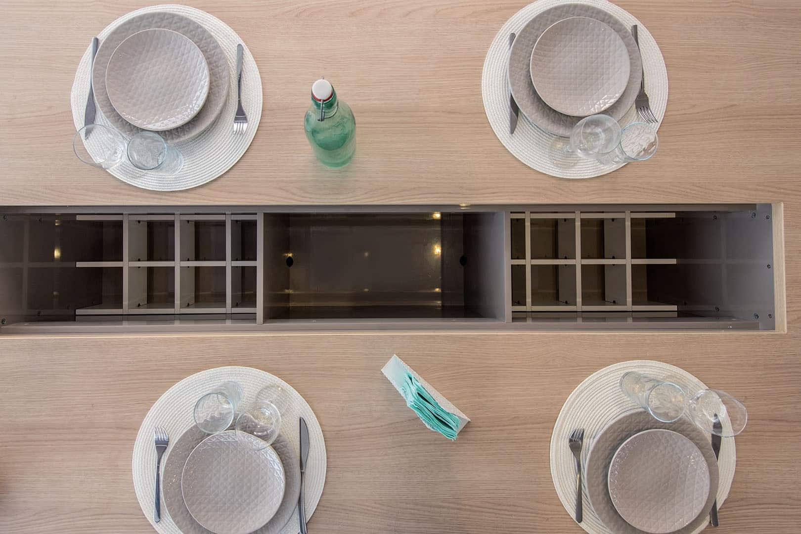 Set dinner table with storage possibilities in the center of the table for bottles and more