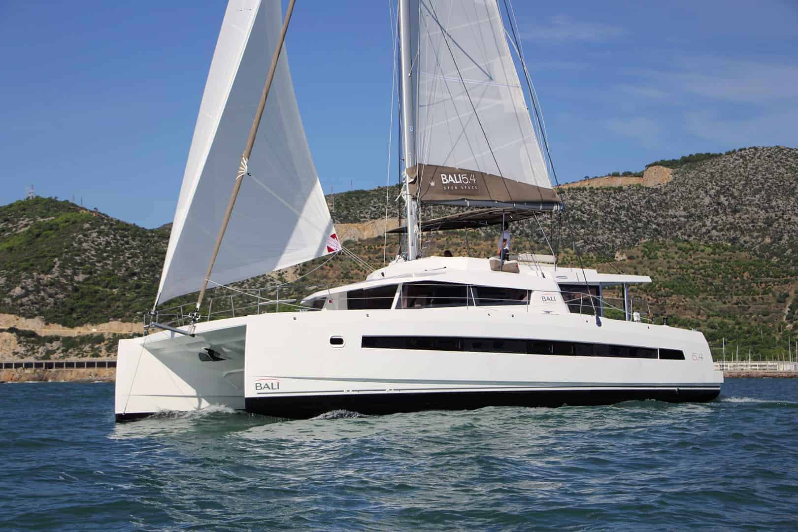 Yacht Bali 5.4 on the ocean with wind in its sail