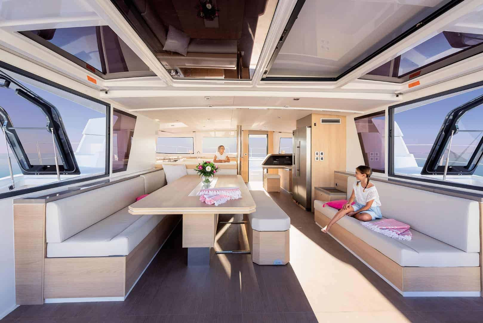 Spacious and elegant cockpit of the Bali 5.4 with two girls chatting with each other