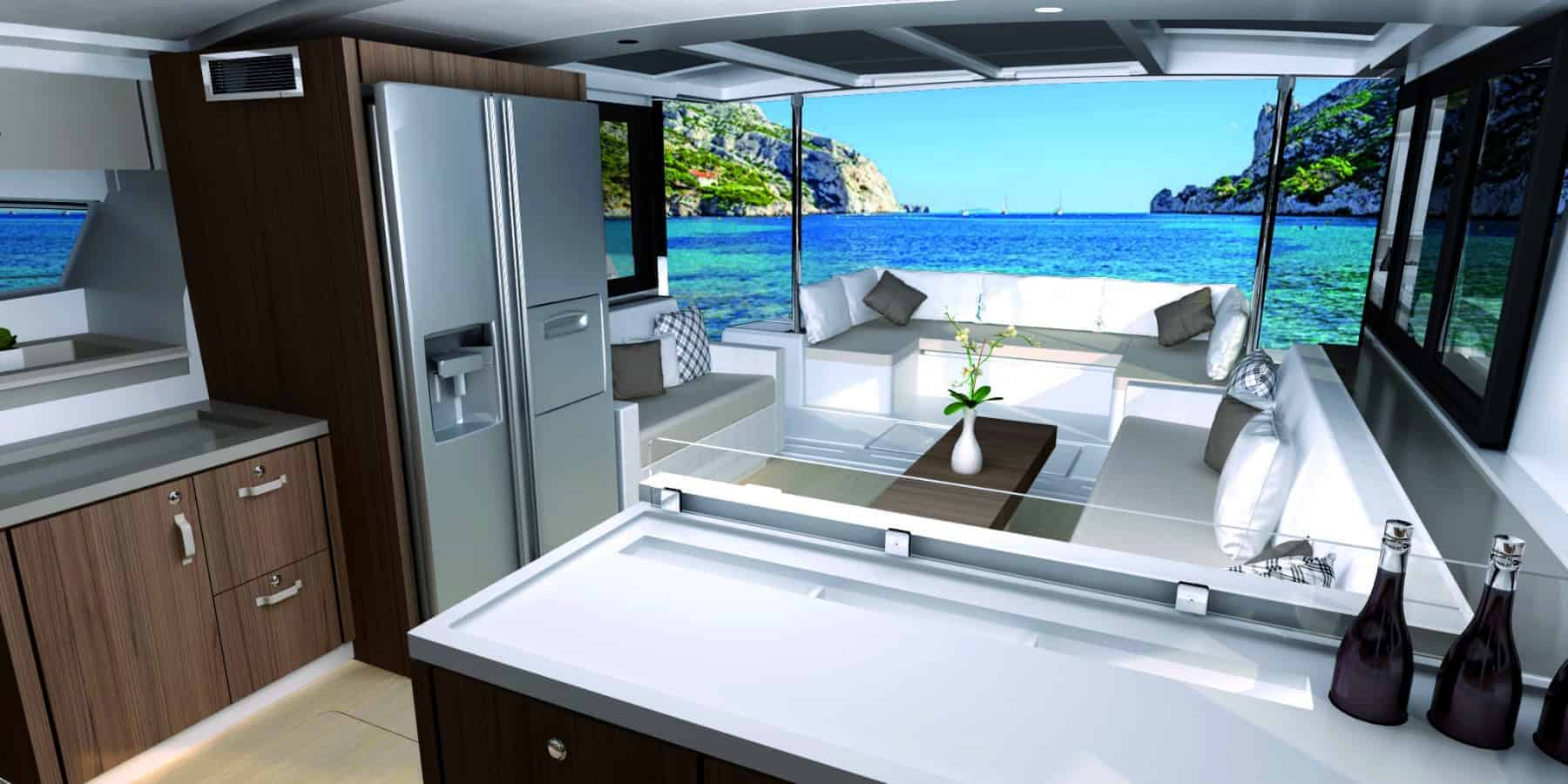 White galley countertop in the foreground with an overview of the elegant fridge and freezer and saloon of the Bali 4.3 MY Revolutionary