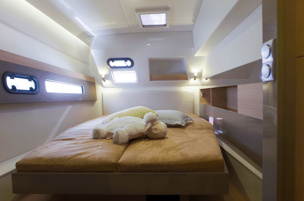 A good looking cabin in one of the hulls of a Bali 4.5 with a stuffed animal on the bed