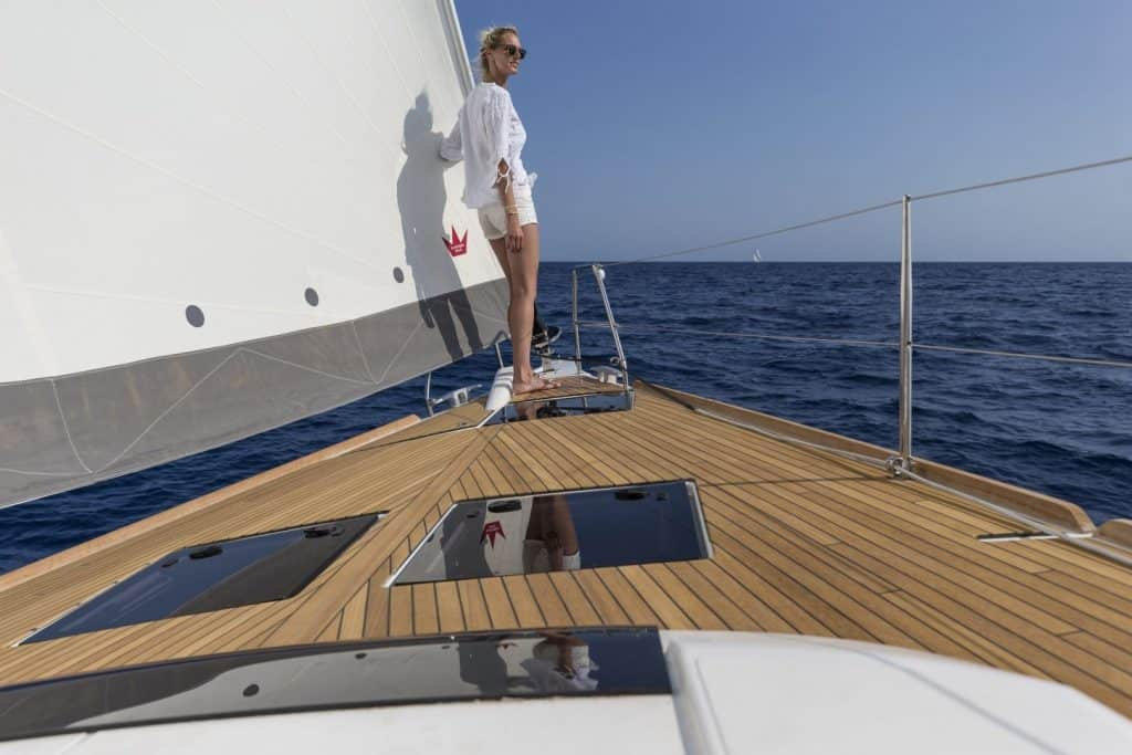 Women enojying the sun while looking out over the ocean from the massive front deck of the Dufour 520 GL