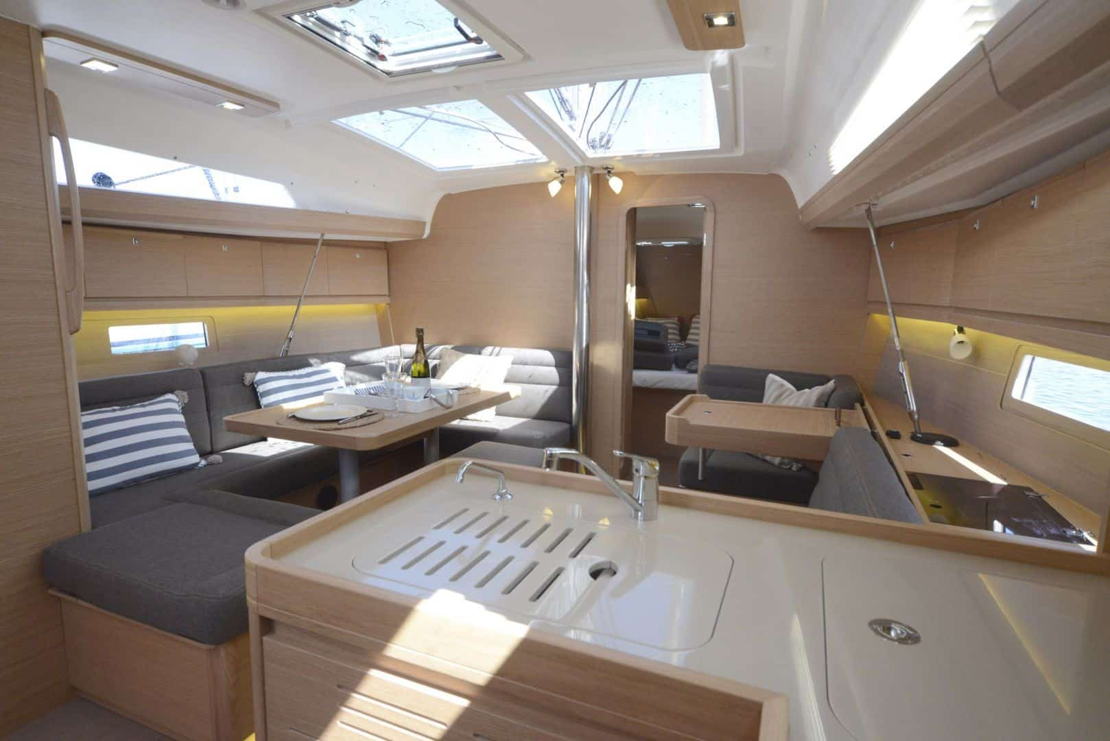 The light and comfy saloon of Dufour grand large 412 with the smart galley sink in the foreground