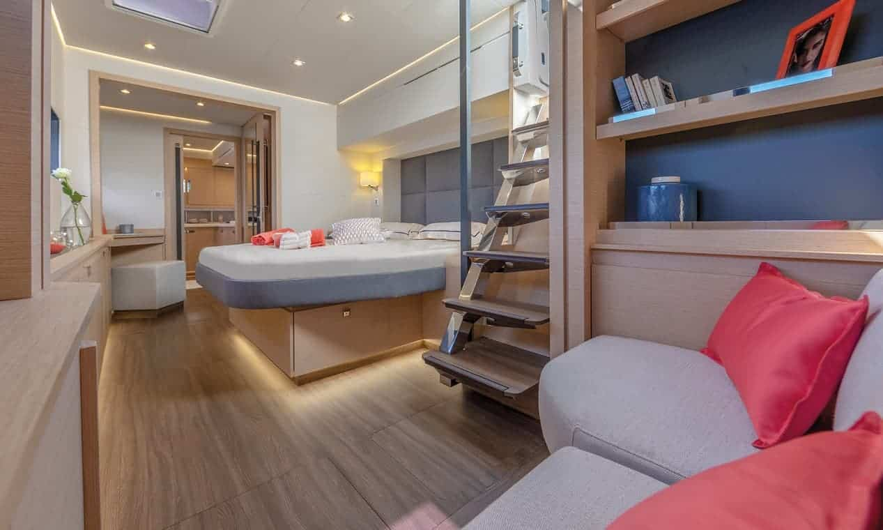 Minimalistic and luxurious cabin with double bed, sofa and bookshelf
