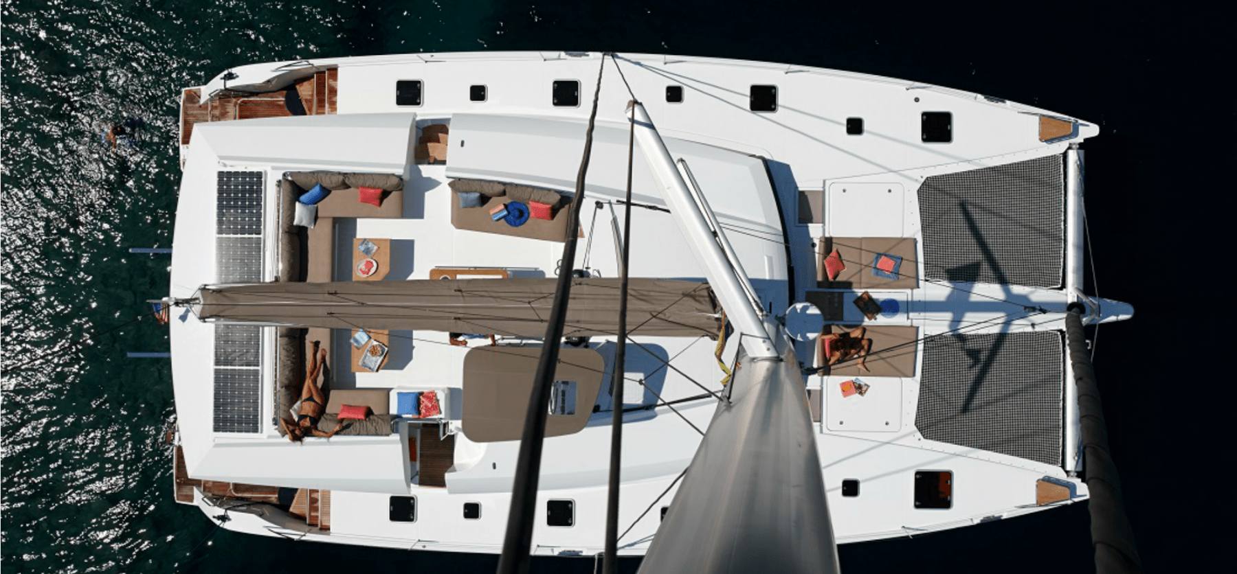 Overview of the massive deck with several spacious sun bathing areas of the Pajot Ipanema 58