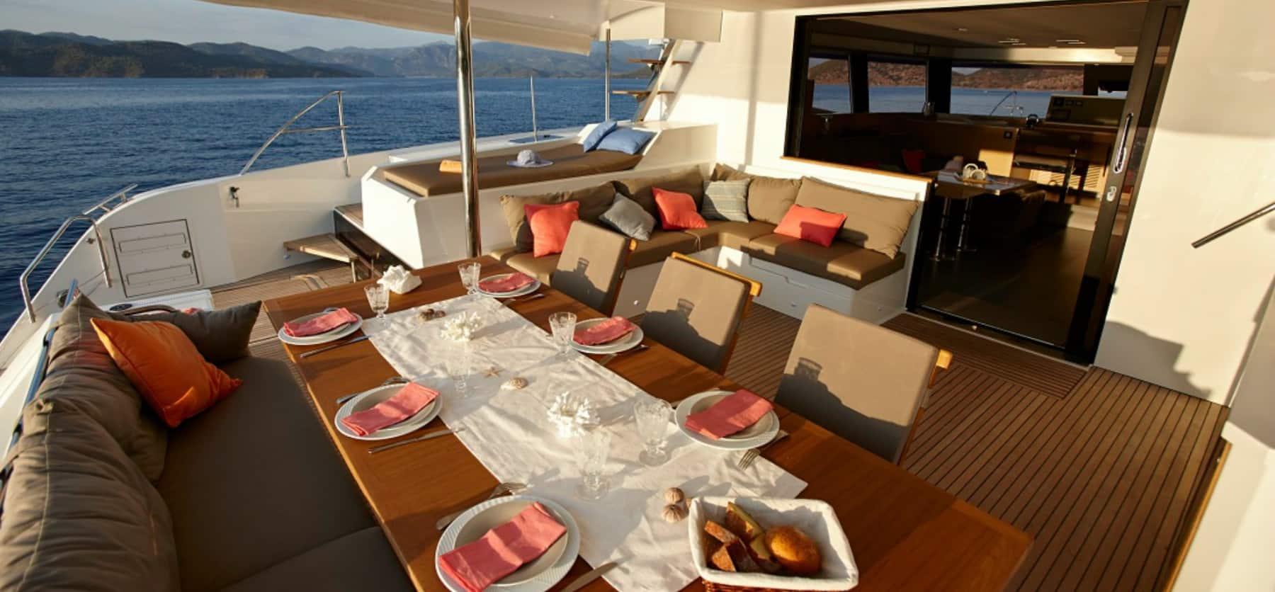 Table set for a romantic evening on the cockpit area of the Pajot Ipanema 58
