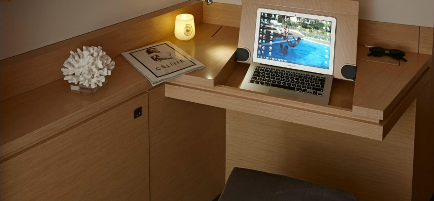 Minimalistic desk with room for a computer in the saloon of the Fountain Pajot Ipanema 58