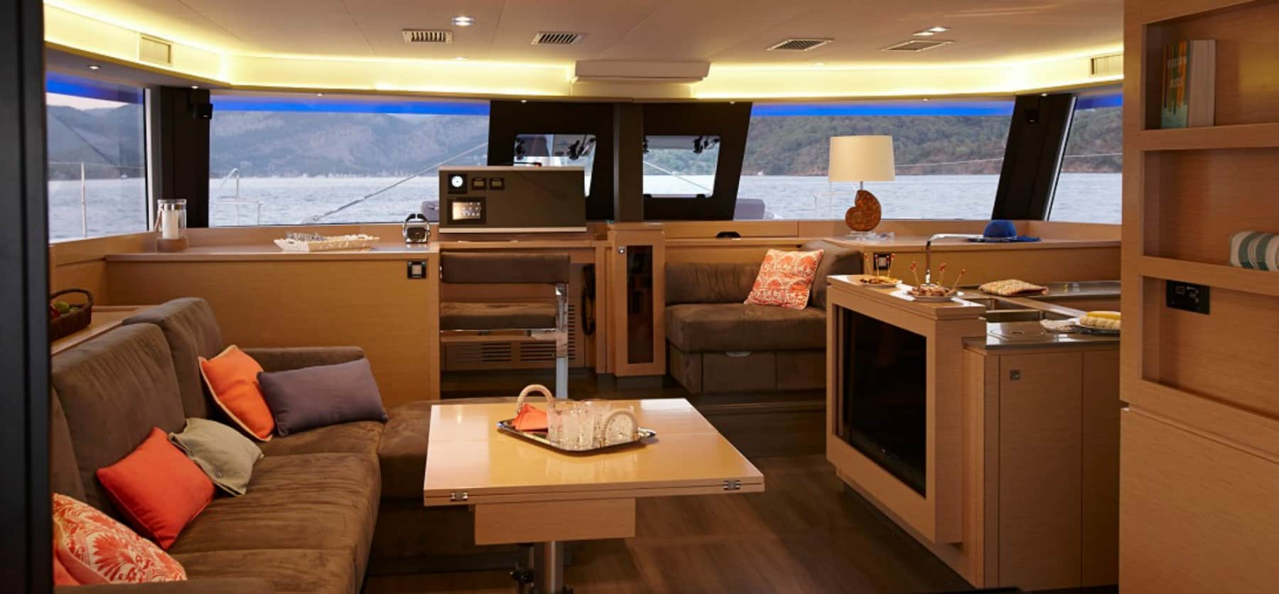 Luxurious and spacious saloon and galley of the Pajot Ipanema 58